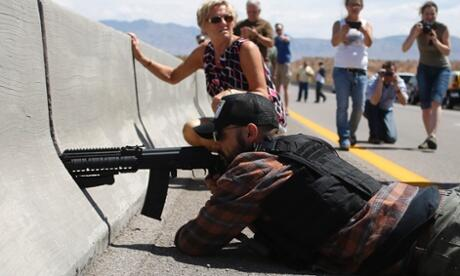 A peaceful protester takes aim at BLM agents