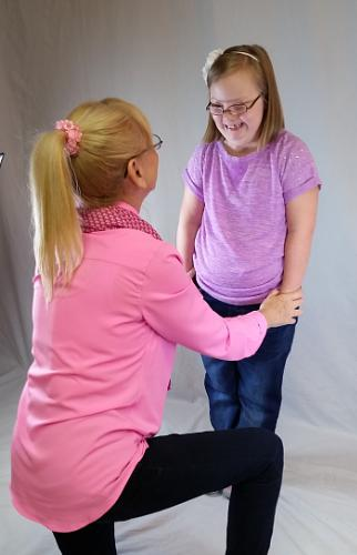 "Maggie, the inspiration behind Downs Designs, sharing a special moment with grandma, Karen Bowersox, during a photo shoot wearing her namesake ""Maggie"" jeans [Image Credit: PRNewsFoto/Downs Designs]"