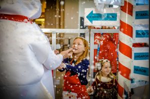 children are greeted by a whimsical North Pole inside the airport