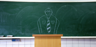 Image of a teacher drawn on a blackboard behind the podium