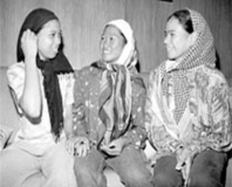 Three released Abu Sayyaf hostages, one of which is identified as Maria Fe Rosadeno. The source doesn't indicate which is which.