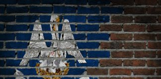 Louisiana state flag on brick wall