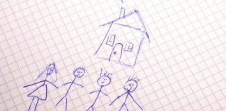 image of an ink drawing by a child of happy family with house