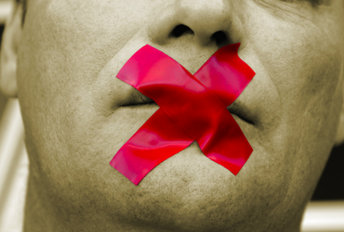 image of tape over mouth to silence speech