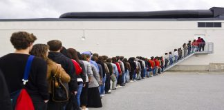 people waiting in line to vote